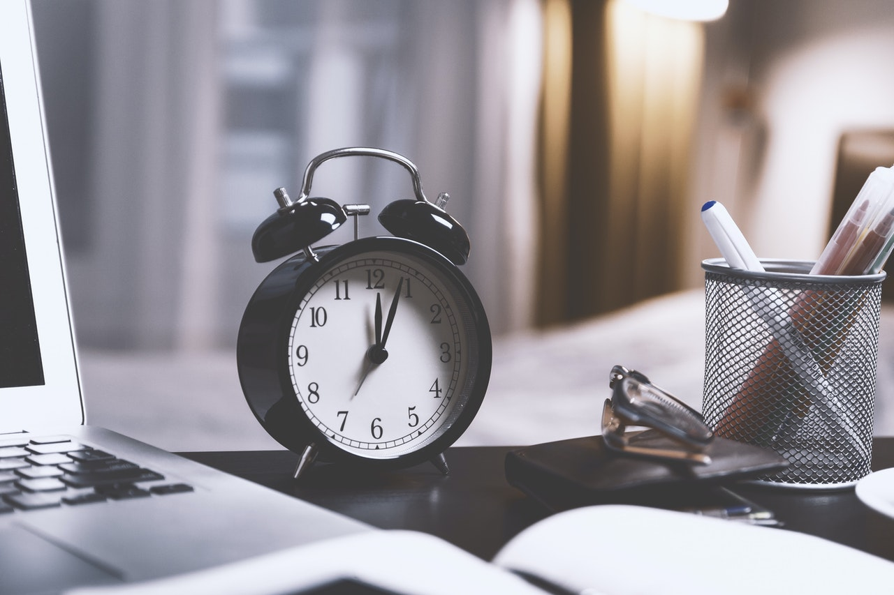 black twin bell alarm desk clock on table 714701